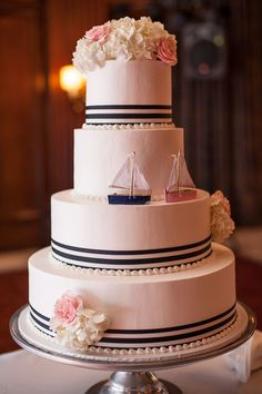 Gorgeous nautical wedding cake with sweet sailboat details! {Kristen Penner Photography}