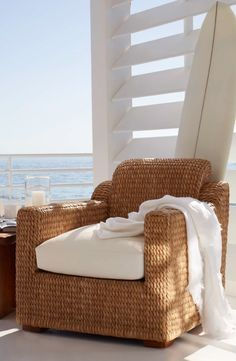 Curl up beachside in Ralph Lauren Home's woven rush Raymond Club Chair