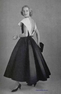 Model wearing a dress by Chanel, 1957.