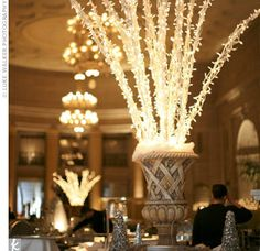 """""""We wanted white lights everywhere,"""" says Megan. Twinkling branches, stationed at each bar, added holiday flair to wintry reception decor."""