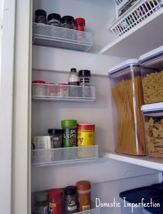 Pencil drawer organizers screwed to the wall for extra pantry storage