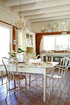 So delightfully beautiful. I love the blend of shabby chic and colonial touches in this rustic, elegant kitchen.