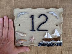 House number plaque ceramic house numbers beach by Sallyamoss Pottery Houses, Ceramic Houses, Slab Pottery, House Name Plaques, House Number Plaque, Door Plaques, Clay Projects, Clay Crafts, Ceramic House Numbers