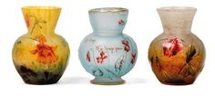 Three small etched glass vases by Daum,