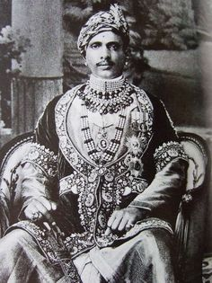 Maharaja Sawai Jai Singh Bahadur of Alwar, born 1882. Besides his traditional Indian ornaments, he wears the star insignia of  the Indian orders granted to him by the British (Raj), then considered a  part of the royal regalia.