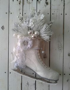 Vintage Ice Skate    Welcome your guest this Holiday season with this winter ice skate. This upcycled ice skate has been cleaned up and lightly