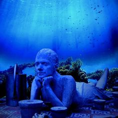 The Underwater Museum off the coast of Cancun, Mexico features 1,000 sculptures out of a chemical compound that speeds up the process of coral growth.  Pretty soon they'll be covered in colorful coral, teeming with ocean life. The exhibit can be seen by either diving or snorkeling.