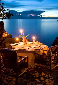 Candles flicker softly on a table set for two, There's no one on the earth tonight, just you & I!