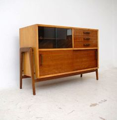 Robin Day; Sycamore, Walnut, Brass and Glass Sideboard for Hille, 1950s.