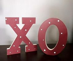 "Ours exclusively, 6 1/2"" tall, block X and O, are perfect Valentine décor! Free standing, these can go anywhere, shelf, mantle, window sill, table, or on steps! In cranberry red with white polka dots, this are just adorable!    http://www.dmzdesigns.com/block-letters-standing-p-1149.html"