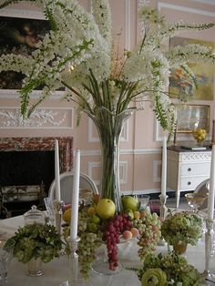 another great use of #cake stands to get that vase up a bit higher and a spot to put fruits; what is that flower?