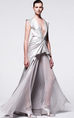 This hammered silk silver-grey J.Mendel gown features a plunge v-neck, suspended layered cap sleeve detail and pleated gathered detail with a tonal sheer pleated chiffon gusset at the front.Hidden zip back closure100% silkPartially linedMade in USAPlease note:This item may be returned for M'O credits.