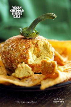 Vegan Cheese Ball. Nut-free Cheddar Cheese ball for Halloween. Shape like pumpkin or make a Jack o lantern. | VeganRicha.com