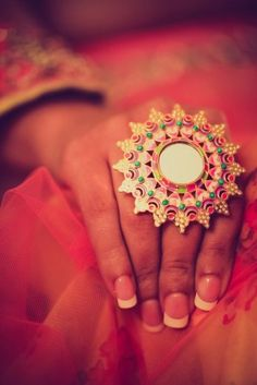 Kundan polki engagement ring. Pretty french manicure.