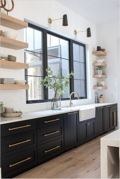 Home Interior Modern Love the sophisticated look of black kitchen cabinets with white oak floating shelves.Home Interior Modern Love the sophisticated look of black kitchen cabinets with white oak floating shelves Best Kitchen Cabinet Paint, Black Kitchen Cabinets, Painting Kitchen Cabinets, Kitchen Cabinet Design, Black Kitchens, Modern Kitchen Design, Interior Design Kitchen, Kitchen Backsplash, Kitchen Fixtures