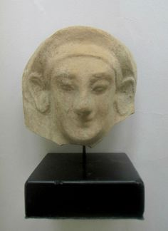 Greek Antiquities - Archaic Protome Terracotta Protome in the form of a woman's head with archaic smile, wearing a stephane… / MAD on Collections - Browse and find over 10,000 categories of collectables from around the world - antiques, stamps, coins, memorabilia, art, bottles, jewellery, furniture, medals, toys and more at madoncollections.com. Free to view - Free to Register - Visit today. #GreekAntiquities #MADonCollections #MADonC Greek Antiquity, Mold Making, Antiquities, Terracotta, Bottles, Mad, Coins, Stamps, Household