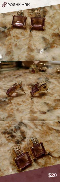 Jewelry Wonderful pair Swarovski Earrings. Amethyst color stones. Has Swan mark on back of earrings. Swarovski Jewelry Earrings
