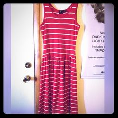 Liz Claiborne Sport Striped Dress Beautiful rich red and white color, with a tank top style top, and a fun, twirly bottom! 100% cotton for a comfy fit, and will fall differently length wise depending on your height! Looks great paired with heels and a statement necklace! Perfect to stay cool, while looking hot this coming spring and summer! Has some stretch to it! Liz Claiborne Dresses