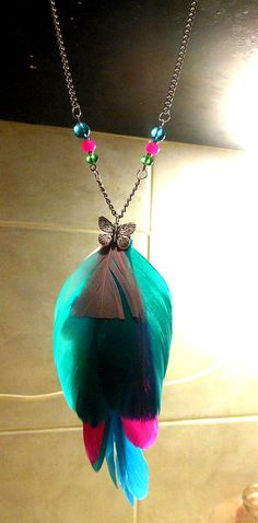 Multicolor feather necklace with silver tone butterfly charm and colorful beads