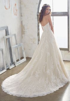Wedding Dresses and Bridal Gowns by Morilee designed by Madeline Gardner. Vintage Bridal Gown with Lace AppliquŽés on Net, a Scalloped Hemline and Button Details.