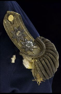 Worn on Nelson's Trafalgar uniform, one epaulette has been partially damaged by the shot that killed him