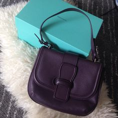 Tiffany Leather Bag Authentic Tiffany & Co. leather bag. High quality. Versatile deep purple color which goes with many outfits. Well maintained and in almost new condition. Tiffany & Co. Bags Hobos