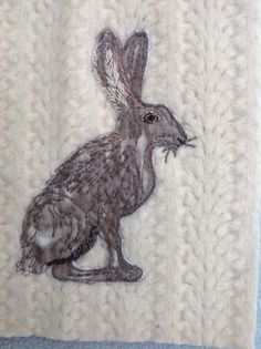 Quick stitched hare on scrap of old felted sweater!