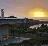 Located on Waiheke Island to the east of Auckland, New Zealand is the Island Retreat -- a compound of low-impact freestanding structures. Designed by Fearon Hay Architects with interiors by Penny Hay, Island Retreat is powered with a stand-alone photovoltaic system, harvest rainwater and manages its wastewater on site.