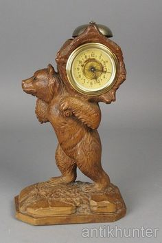Black forest bear mantle clock with glass eyes , swiss antique , brienz