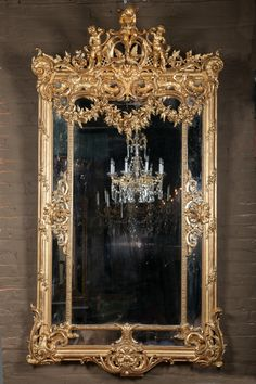Large French 19th century Louis XVI elaborately carved giltwood mirror
