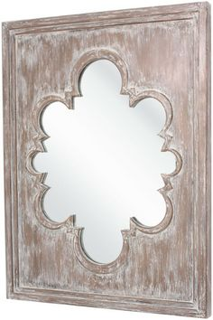 This mirror has a wonderful old world feel with it's unique shape and antiqued frame. From Surya. (MRR-1001)