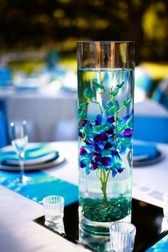 With pink stones  | wedding flower arrangements. Blue Orchids.