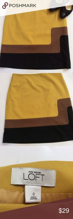 "Ann Taylor Loft  mustard colored skirt! The skirt is mustard, brown and black colored. It's length is 19 3/8"" from waist to hem. Has never been worn. Looks snazzy with black pumps!! Ann Taylor Loft  Skirts Midi"