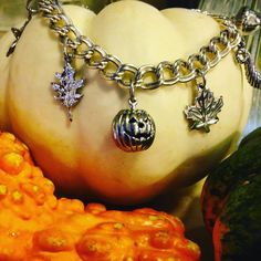 Spiders, pumpkins, and leaves OH MY! Get this cute fall season charm bracelet and more on the Gold Creations website!