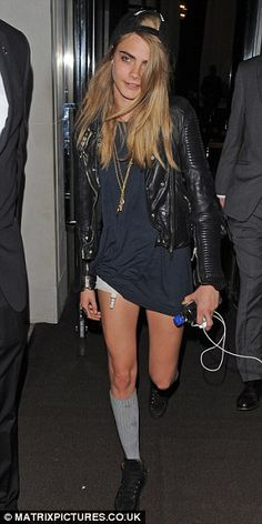 Forgotten something, Cara? The model was seen partying with Rihanna wearing just a t-shirt and suspender belt