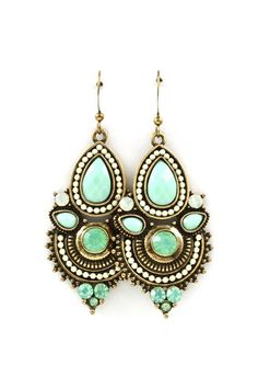 Gorgeous earrings. Would look great with white v-neck and navy or black sweater.