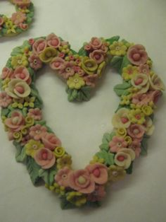 coloured dough has been used to create this large heart wall hanging