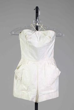 White cotton halter-neck bathing suit with pockets, by Carolyn Schnurer (textile by Wamsutta), American, 1951.