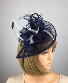 A personal favourite from my Etsy shop https://www.etsy.com/uk/listing/552584823/dark-blue-navy-blue-and-white-fascinator