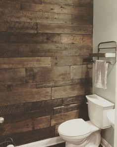 Powder-room with barn-wood accent wall. Vanity from ...