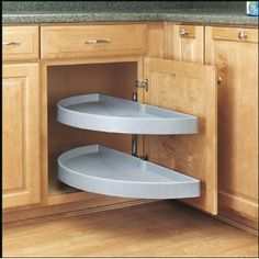 corner round pullout shelves - For that one cabinet that I'm not sure what is up there.