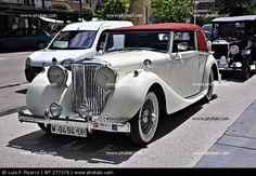 Afbeelding van http://p1.pkcdn.com/voorkant-van-een-oude-auto-jaguar_277376.jpg.