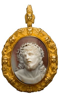 Ecce Homo Shell Cameo Pendant, Mid 19th Century. Composed of gold and shell. Inspired by Guido Reni's paintings of this subject which shows Christ being presented to the people, crowned with thorns and wearing a purple robe. Christ is framed within a border of angels who seem to be singing his praises, like a choir.