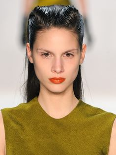 Punked out makeup and french twists at Narciso Rodriguez.  Shiseido Rouge Lacquer in Savage