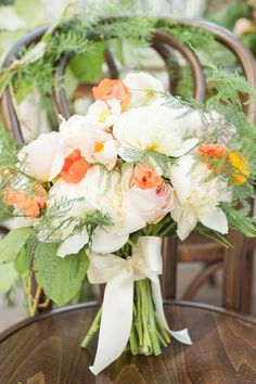 Bouquet - A touch of pink, a little more peach and a lot of ivory with greenery ... More wedding inspiration on SMP: http://www.StyleMePretty.com/2014/01/28/bohemian-garden-wedding-inspiration/ Photography: Twah Dougherty