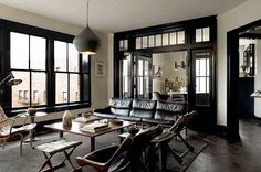 white walls, black door and window frames, modern home