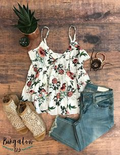Great little strappy top in White featuring an allover floral print. Empire waist with ruffle trim. 100% Rayon. Shown with the Harlowe Jeans in Light Wash and the Aineed Sandals.