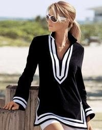 Summer outfits: A simple tunic with white walking shorts, and simple flip-flops is a classic summer staple.