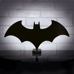 Let the Dark Knight light up your own dark night with this awesome Batman Logo Eclipse Light. This cool lamp puts Batman's emblem on your desk as a decorative lamp. The Batman Logo Eclipse Light features the famous Batman symbol, which emits light to help brighten up your own Batcave. It