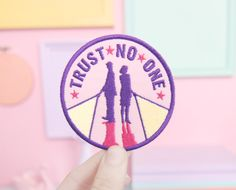 Show your love for The X-Files with this sew-on patch that says Trust No One with Mulder and Scully in shadow.